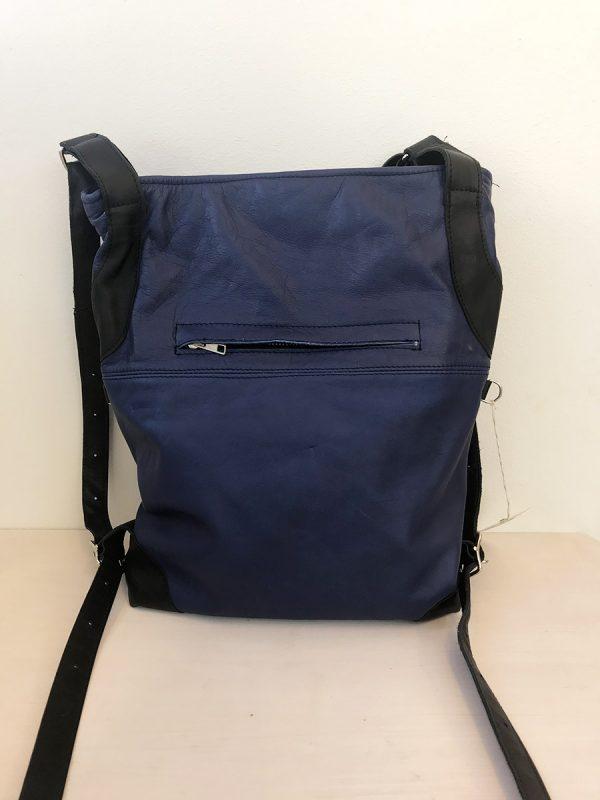 sininen laukku takaa